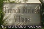 sign in front of French Riviera Village in Coral Springs